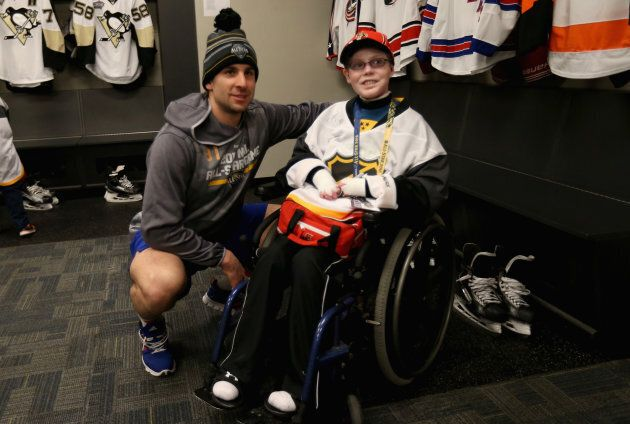 John Tavares of the New York Islanders meets with Jonathan Pitre on Jan. 30, 2016 in Nashville, Tennessee.