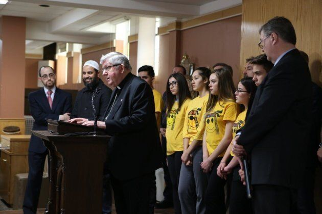 Cardinal Thomas Collins joins interfaith leaders in January for a press conference calling on the government...