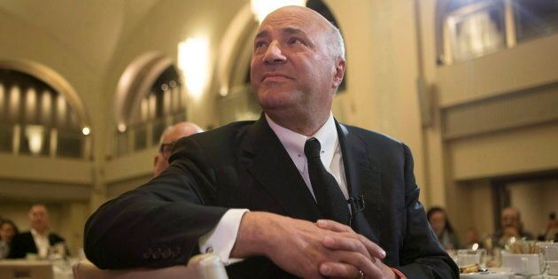 Kevin O'Leary listens to introductory remarks before speaking at the Empire Club luncheon in Toronto,...