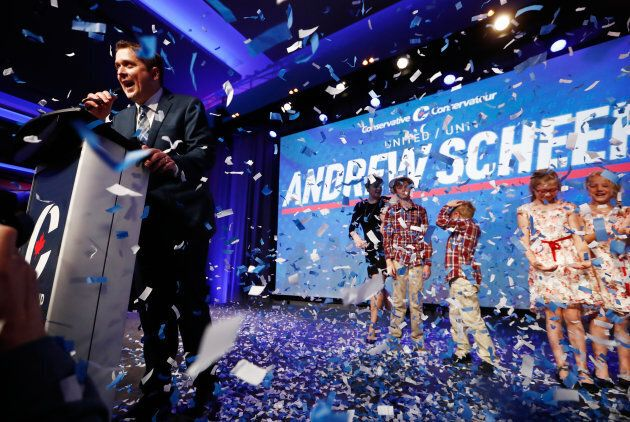Andrew Scheer speaks as confetti falls after winning the leadership during the Conservative Party of Canada leadership convention in Toronto on May 27, 2017.