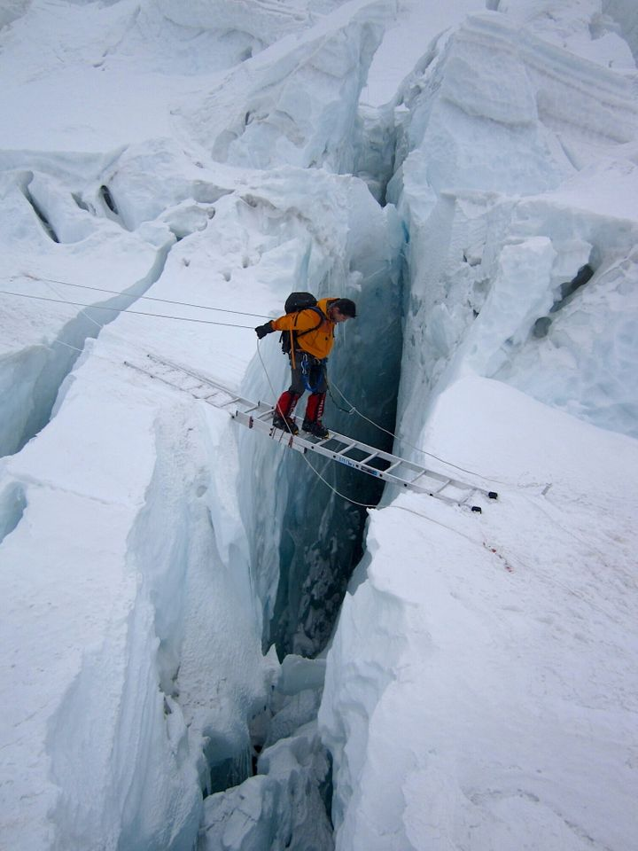 The author on a ladder in the Khumbu Icefall