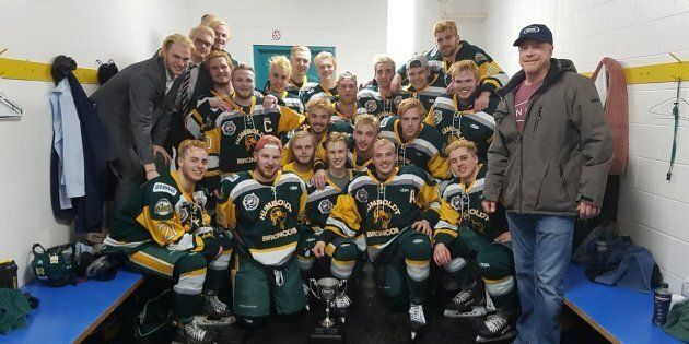The Humboldt Broncos celebrate with the Bourgault Cup after a big win on March 25,