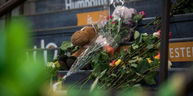 Community members leave notes and flowers at a memorial for the Humboldt Broncos team leading into the...