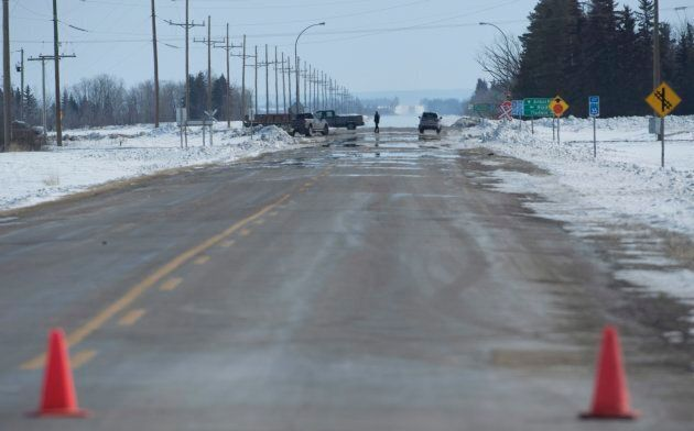 The closed highway 335 looking towards the crash site and highway 35 intersection just outside of Tisdale,...