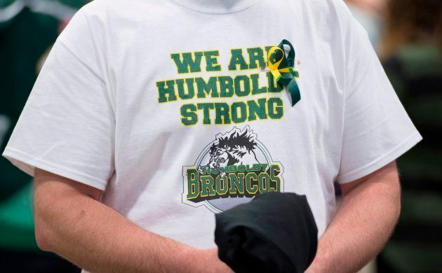 A man wears a Humboldt Broncos shirt during a vigil at the Elgar Petersen Arena, home of the Humboldt