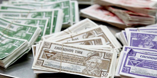 Canadian Tire Corp. money sits bundled together in stacks at a store in Toronto on Jan. 18,