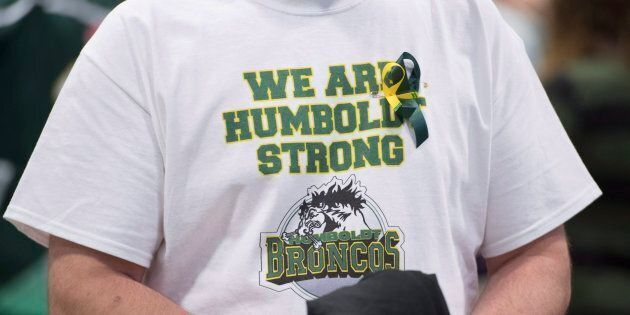 A man wears a Humboldt Broncos shirt during a vigil at the Elgar Petersen Arena, home of the Humboldt Broncos, to honour the victims of a fatal bus accident in Humboldt, Sask. on April 8, 2018.