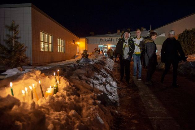 Community members leave a vigil at the Elgar Petersen Arena, home of the Humboldt Broncos, to honour...