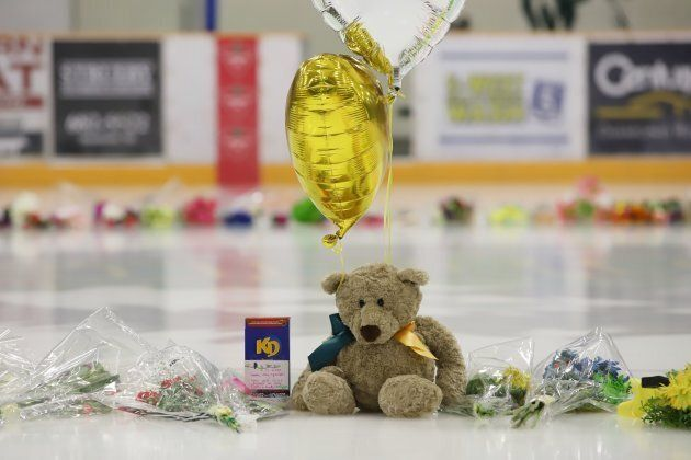 Flowers, cards and sentimental gifts adorn the ice surface at Humboldt Uniplex during preparations for...