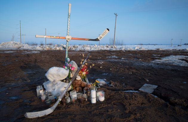 A makeshift memorial at the intersection of the fatal bus crash near Tisdale, Sask. on Tuesday.