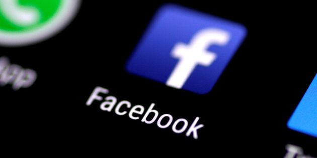 The Facebook application is seen on a phone screen Aug. 3,
