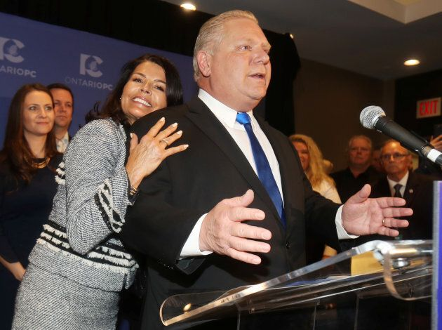 Doug Ford speaks with his wife Karla in Markham, Ontario on March 10,