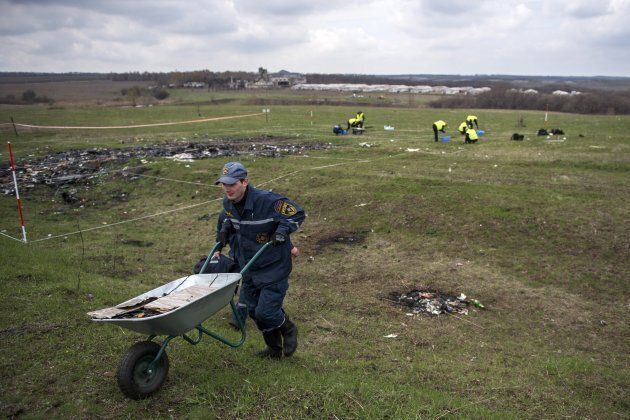 Dutch and Malaysian investigators and local authorities work on April 16, 2015 at the MH17 plane crash site near the village of Grabove in the self-proclaimed Donetsk People's Republic. The plane was shot down over war-torn eastern Ukraine.