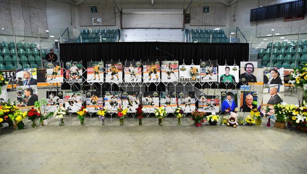 Photos of people involved in a fatal bus crash are seen before a vigil at the Elgar Petersen Arena, home of the Humboldt Broncos, in Humboldt, Sask. on April 8, 2018.