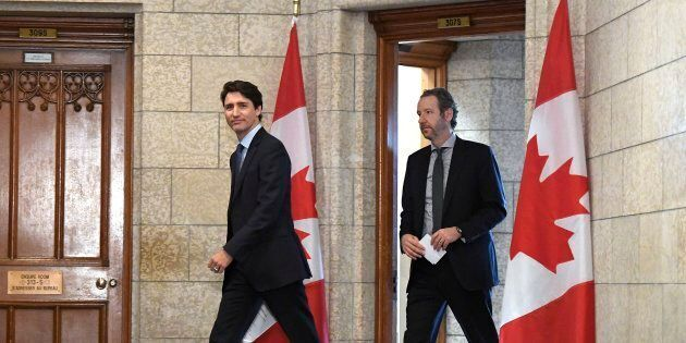 Prime Minister Justin Trudeau leaves his office with his principal secretary Gerald Butts to attend an...