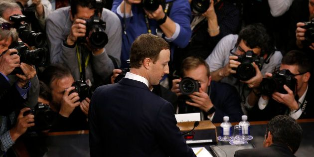 Facebook CEO Mark Zuckerberg arrives to testify before a Senate Judiciary and Commerce Committees joint...