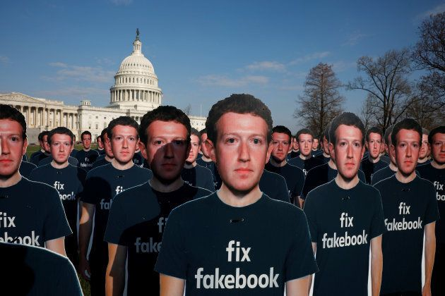 Dozens of cardboard cutouts of Facebook CEO Mark Zuckerberg are seen during an Avaaz.org protest outside...