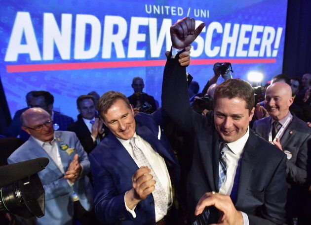 Andrew Scheer, right, is congratulated by Maxime Bernier after being elected the new leader of the federal...
