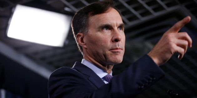 Finance Minister Bill Morneau gestures during a news conference on Parliament Hill in Ottawa on Oct....