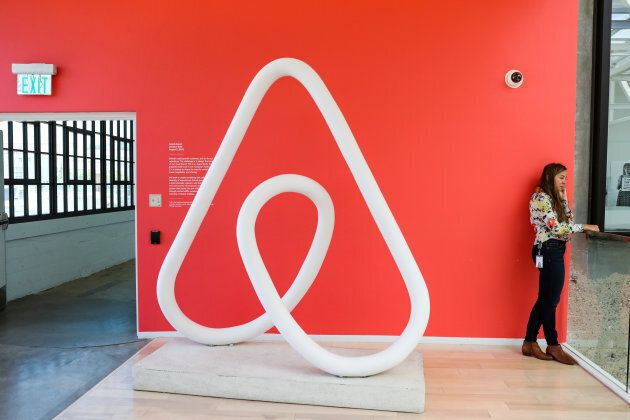 A woman talks on the phone at the Airbnb office headquarters in the SOMA district of San Francisco, California,...