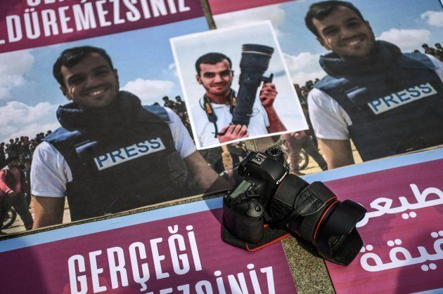 People take part in a protest on April 11 in Istanbul, against the killing of a fellow journalist, Palestinian...