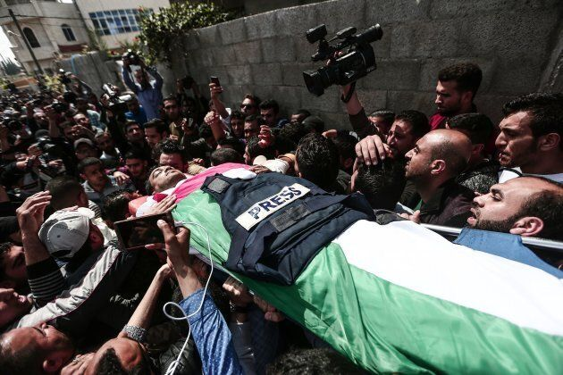 The funeral ceremony for Yaser Murtaja, a Palestinian reporter killed by the Israel Defense Forces while covering a rally on the Gaza border, is held in Gaza on April 7, 2018.
