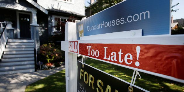 A real estate for sale sign is pictured in front of a home in Vancouver Sept. 22,