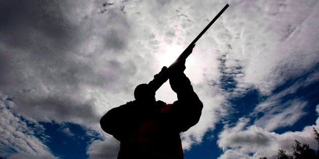 A rifle owner checks the sight of his rifle at a hunting camp property in rural Ontario, west of Ottawa,...