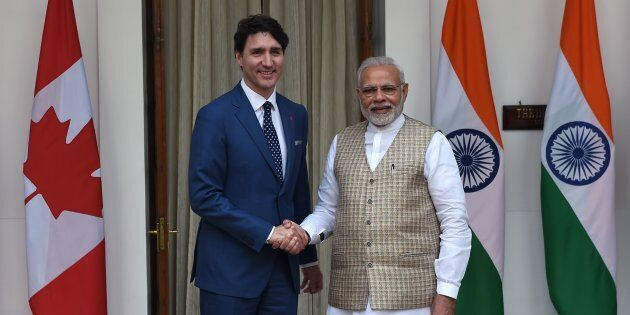 Prime Minister Justin Trudeau and Indian Prime Minister Narendra Modi shake hands before a meeting at...