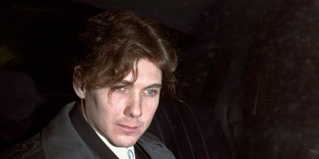 Paul Bernardo sits in the back of a police cruiser as he leaves a hearing in St. Catharines, Ont., April...
