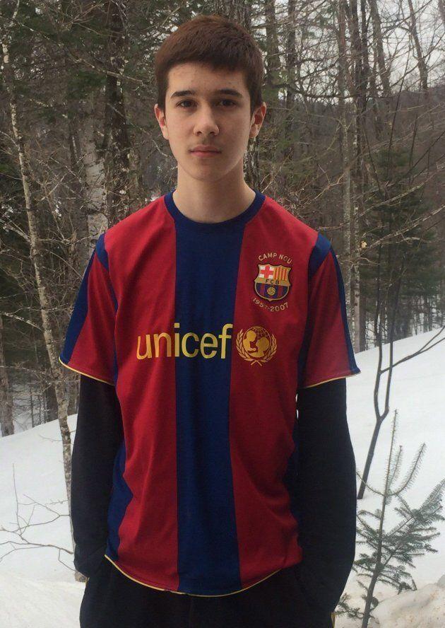 Philippe Volek, 14, poses in this undated handout