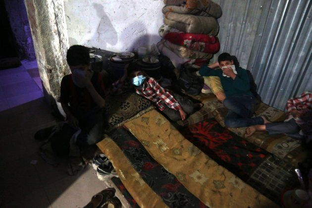 Injured victims of an alleged chemical attack rest in rebels-held Douma, Syria, 08 April