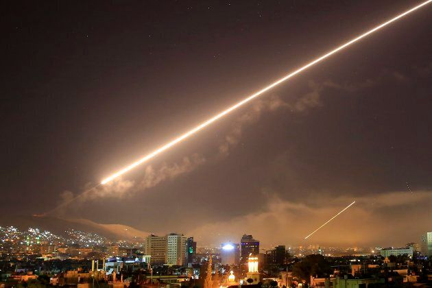 Damascus skies erupt with surface to air missile fire as the U.S. launches an attack on Syria targeting...