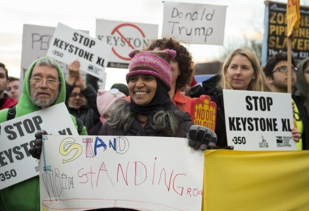 Opponents of the Keystone XL and Dakota Access pipelines hold a rally as they protest US President Donald...