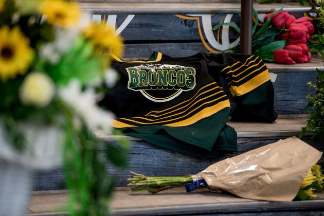 A Humboldt Broncos team jersey is seen among notes and flowers at a memorial for the Humboldt Broncos team leading into the Elgar Petersen Arena in Humboldt, Sask., on April 7, 2018.