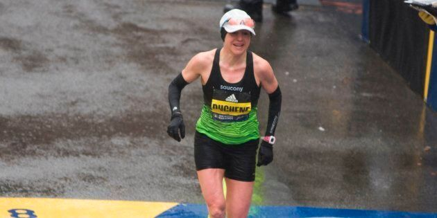 Krista DuChene of Canada crosses the finish line in third place for the 2018 and 122nd Boston Marathon...