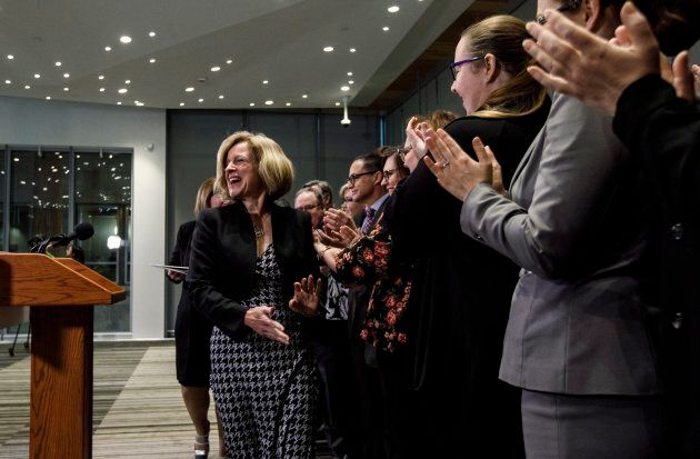 Alberta Premier Rachel Notley is applauded by her caucus at a press conference to announce new legislation...