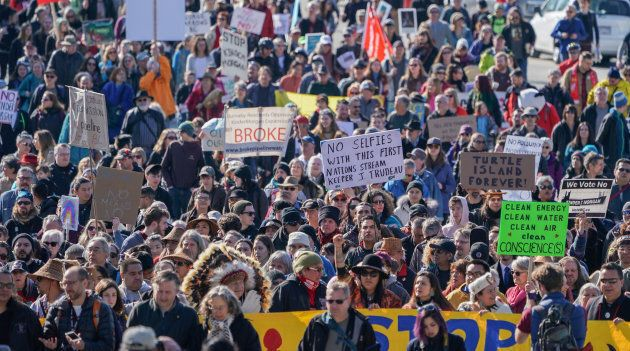 Indigenous leaders and environmentalists march to protest Kinder Morgan's Trans Mountain pipeline expansion...
