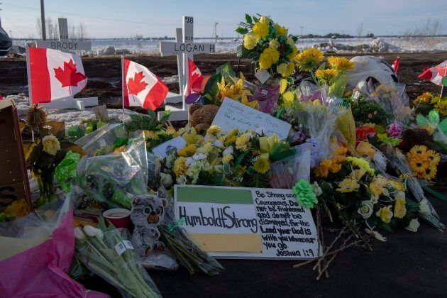 Hockey sticks, messages and other items continue to be added to a memorial at the intersection of a fatal...