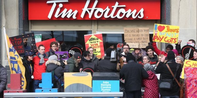 Fight for 15 and Fairness hold a rally outside  the Tim Hortons location on Bloor and Bedford in Toronto on Jan. 10, 2018.