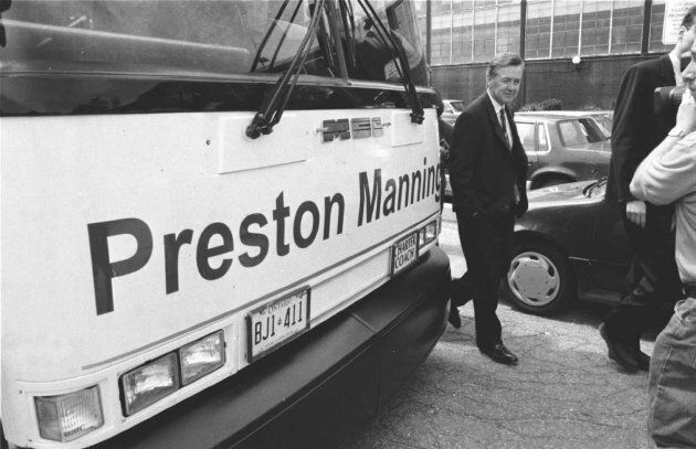 Preston Manning walks by his bus at the Global Television studios on May 23,