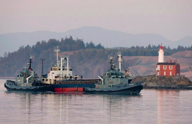 The MV Sun Sea is escorted past Fisgard Lighthouse and into CFB Esquimalt in Colwood, B.C., on Aug. 13,...