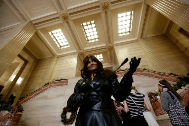 Dominatrix Terri-Jean Bedford was one of three people who initiated a challenge to Canada's prostitution laws. Bedford reacts after the Supreme Court of Canada struck down all restrictions on prostitution on Dec. 20, 2013.