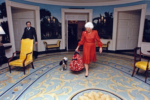 First lady Barbara Bush walks through the Diplomatic Reception Room of the White House with her dog,...