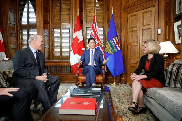 Prime Minister Justin Trudeau meets with British Columbia Premier John Horgan and Alberta Premier Rachel Notley in Trudeau's office, April 15, 2018.