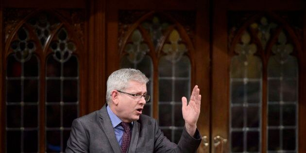 NDP MP Charlie Angus stands during question period ion the House of Commons on Parliament Hill in Ottawa...