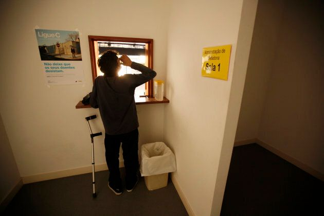 A patient drinks his doses of methadone at a rehabilitation clinic in Lisbon on Aug. 10, 2012. It's one of dozens of clinics across the country, the result of Portugal's pioneering drugs policy.
