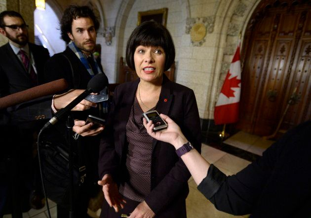 Minister of Health Ginette Petitpas Taylor speaks to reporters following Question Period in the House of Commons on Parliament Hill on April 18, 2018.