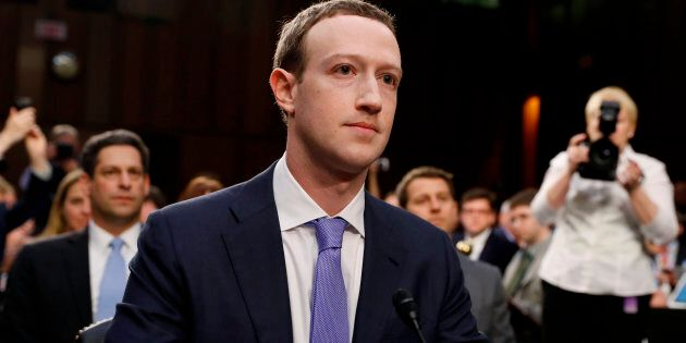 Facebook CEO Mark Zuckerberg listens to opening statements while testifying before a Senate Judiciary...