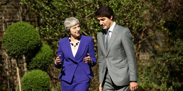 Britain's Prime Minister Theresa May speaks with Prime Minister Justin Trudeau in the gardens of 10 Downing...